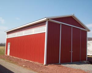 red agricultural pole barn with white trim