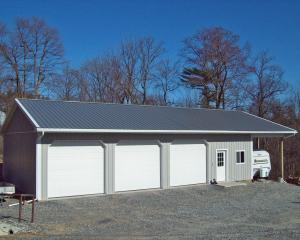 Gray pole barn garage with RV lean to