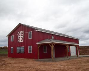 Red commercial pole building with porch