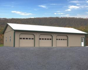 Tan three bay pole barn garage with green trim