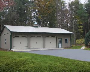 Clay three bay pole barn garage with green trim