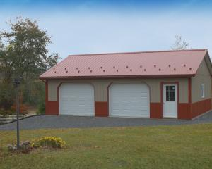 Clay and red pole building garage with two garage doors