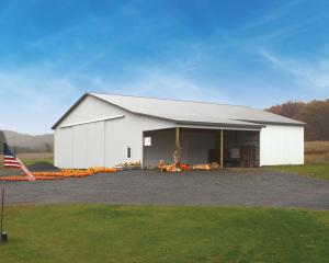 White agricultural pole barn with open area