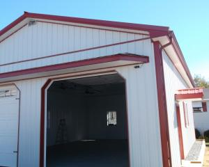 White pole building garage with red trim